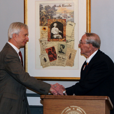 President Garland and Chief Leonard shake hands