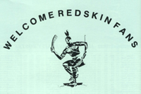 Reproduction of Miami Indian sculpture, with words 'Welcome Redskin Fans'