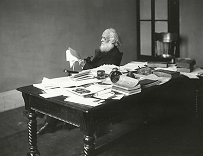 Andrew D. Hepburn at his desk