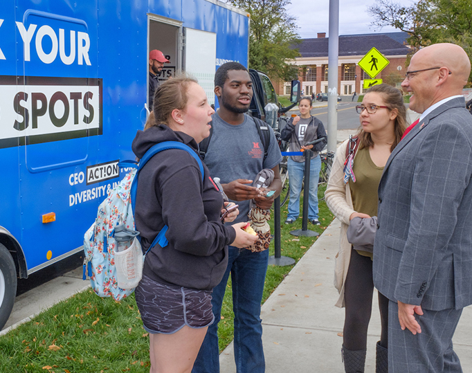 Dr. Crawford talking with students outside the Check Your Blind Spots trailer