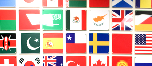 The flags of the world, printed on glass, decorate a wall