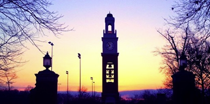 The sun setting on the bell tower