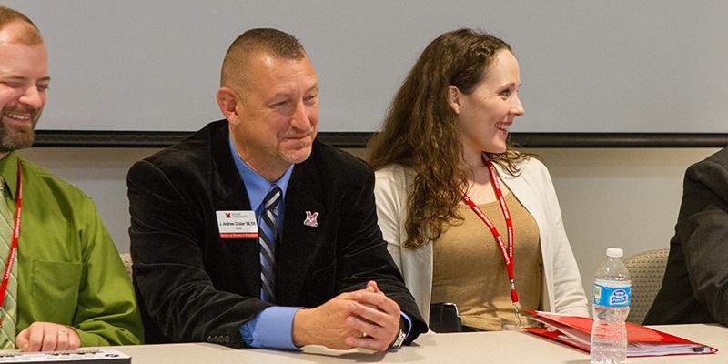 Panel members smiling