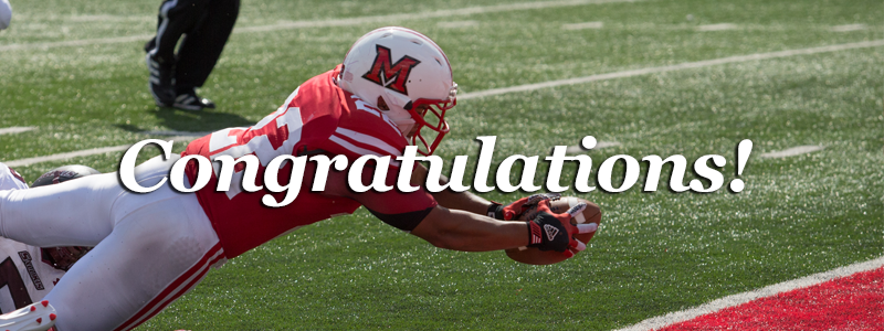 Congratulations! -Football player diving for the football-