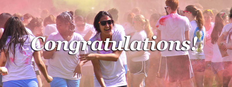 Congratualtions! -Students throw colored powder to celebrate Holi-