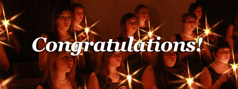 Congratulations! -Chorale holding candles as they sing-
