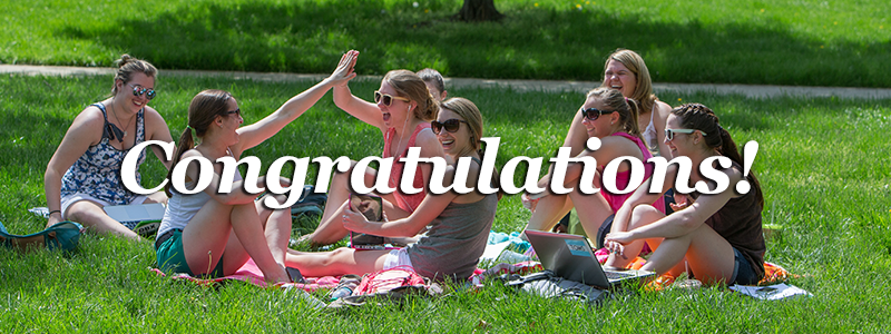 Congratulations! -Girls sitting together in the grass-