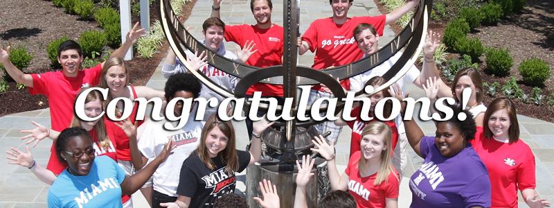 Congratulations! -Miami tour guides pose around the sundial-