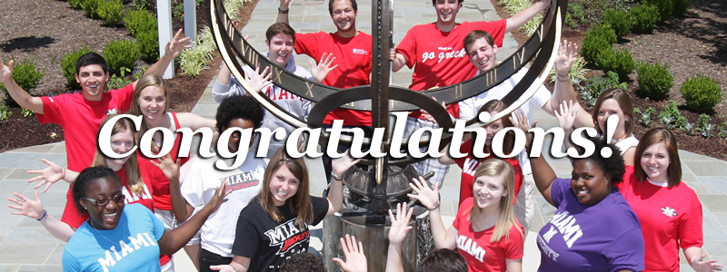 Congratulations! -Miami tour guides pose around the sundial-
