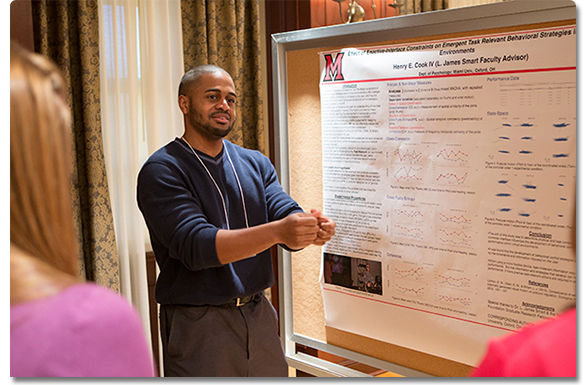 A graduate student presenting research
