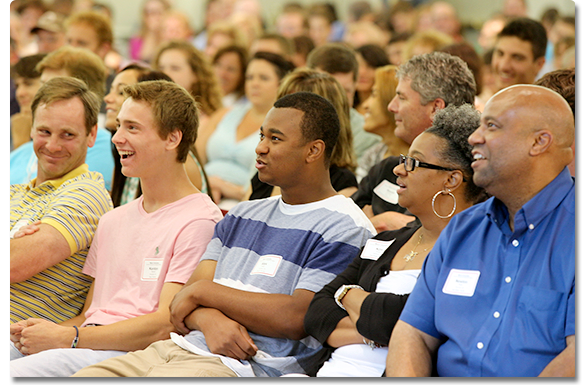 Parents and students laughing.