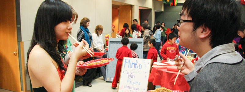 Chinese New Year Celebration at Hamilton Campus, students share a meal and get to know one another