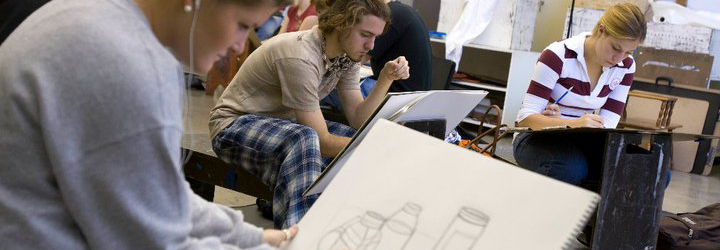 Students working on drawing a still life in charcoal