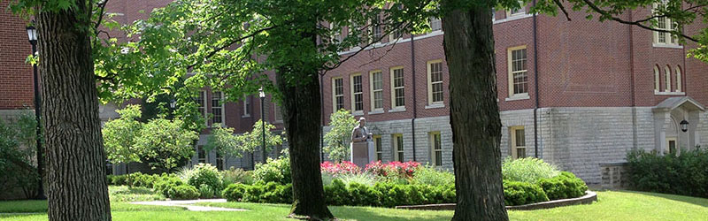 The grassy courtyard of historical McGuffey Hall on a sunny day