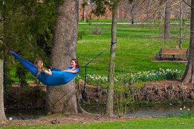 Miami University students in hammock at Dogwood Park