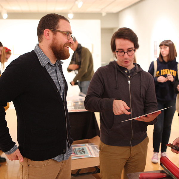 Students discuss art work in one of the galleries