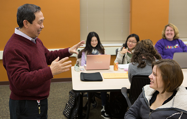 Faculty member engaging with students in classroom
