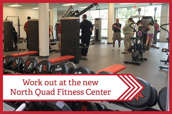 Text - Work out at the new North Quad Fitness Center - overlaying an image of people standing around weights and fitness machines