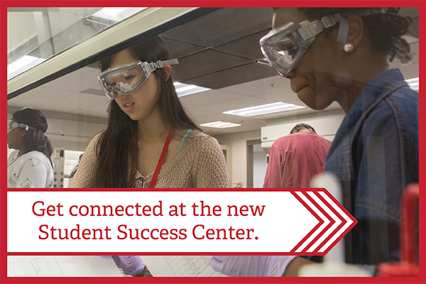Text - Get connected at the new Student Success Center - overlaying an image of two students working together in a science lab