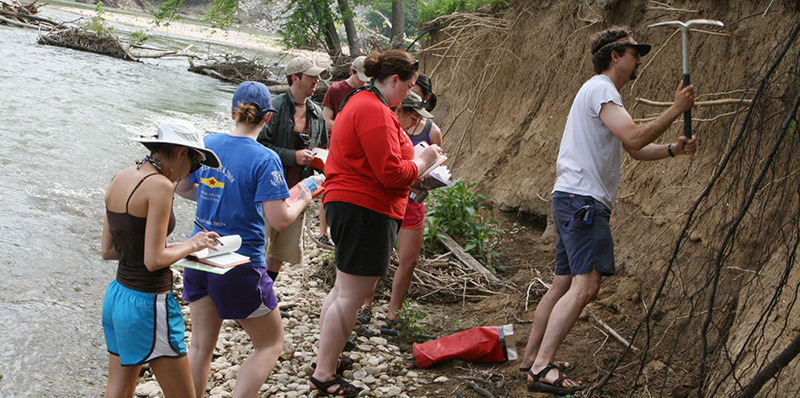 Students dig for samples during geology class.