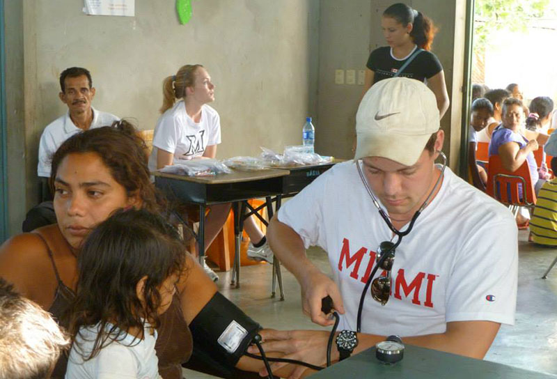 Checking the blood pressure of a child in Nicaragua