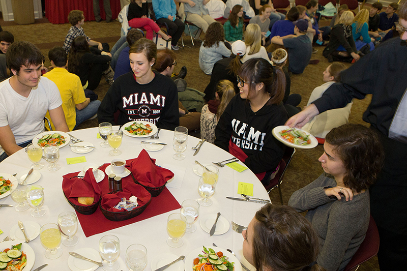 Hunger Banquet participants are divided into roles designating high-income, medium-income, and low-income groups.