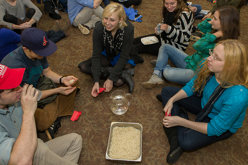 Students learn about social issues at the Hunger Banquet.