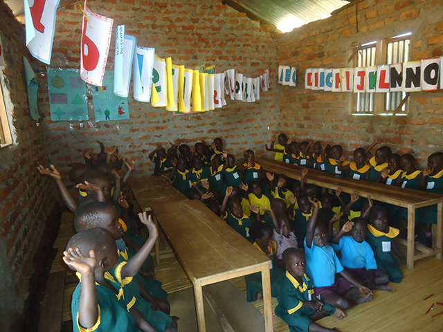 Oxfam helped build and furnish the Otwee-Miami School in Uganda, benefiting these students in the community.