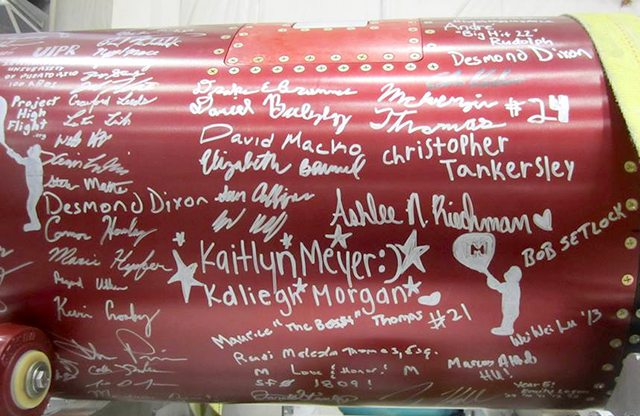 RockOn and RockSat students' signatures on the rocket
