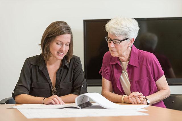 ULIP coordinator Katie Egart visits Maddie Sabatelli at her internship.