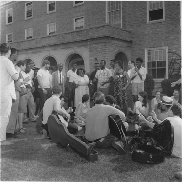 Freedom Summer volunteers sitting on the lawn and sitting