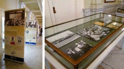 Photo of glass display table and banners from the Freedom Summer traveling exhibit