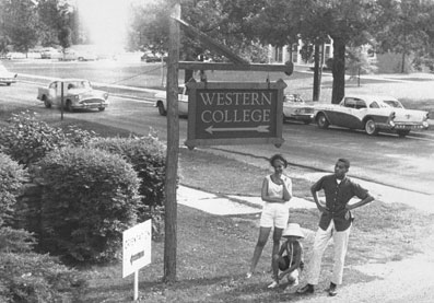 1960s photo with sign pointing to Western College
