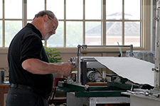 man making the paper for the great seal essay book