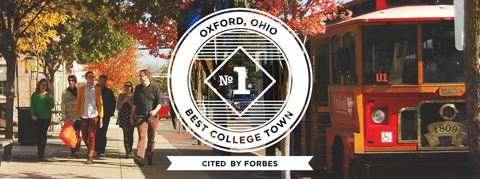 Oxford, OH No1 Best College Town. Ranked by Forbes. Photo courtesy of the Oxford Visitors Bureau. Photo of a group of people walking down the street uptown as a red trolley pulls up to a trolley stop