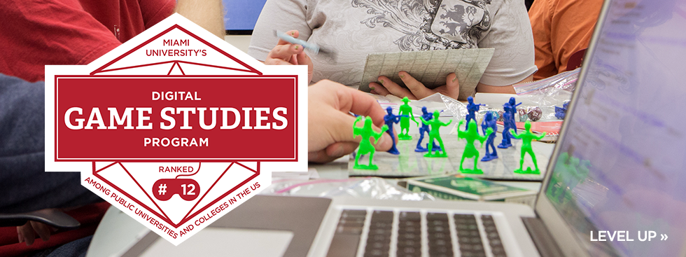 Miami University's digital game studies program ranked #12 among public universities and colleges in the US. Level Up » Photo of a student with army figures and an open laptop.