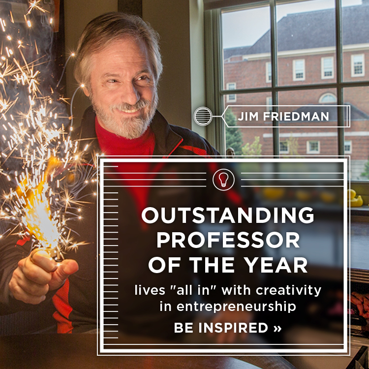 Outstanding Professor of the year lives 'all in' with creativity in entrepreneurship. Be inspired » Photo of Jim Friedman smiling as sparks fly from an object in his hand