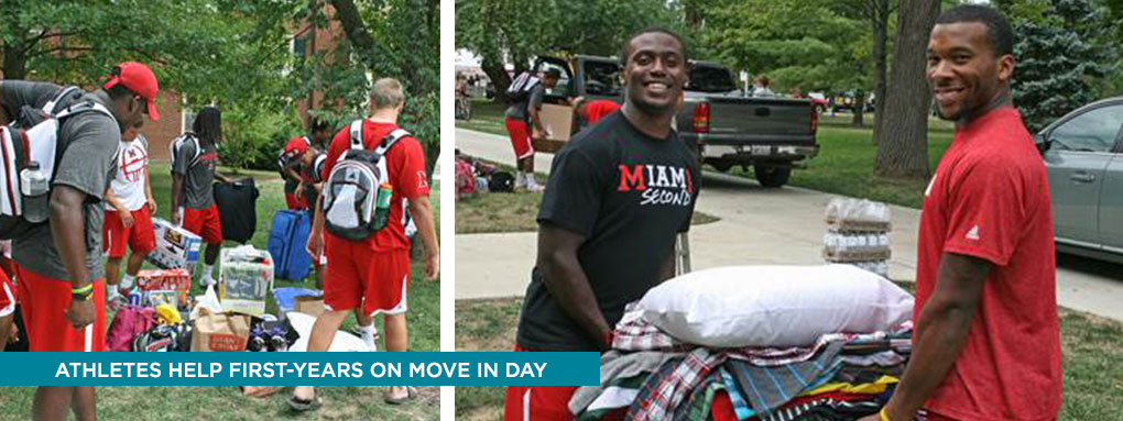 Athletes helping first-years at move in