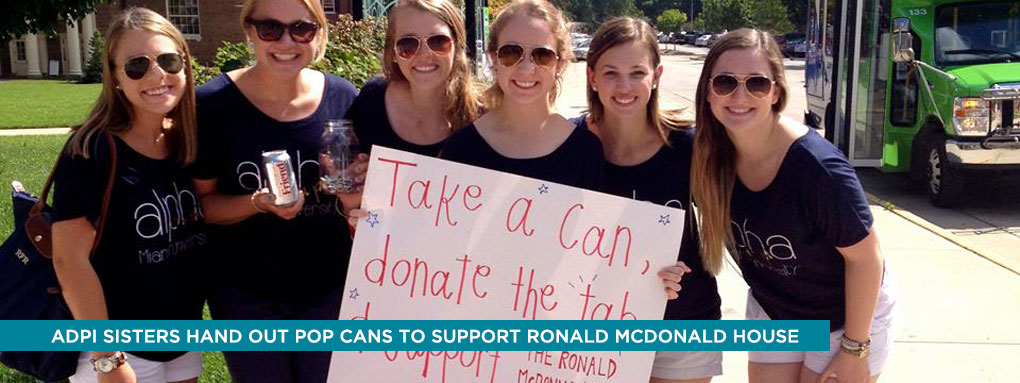 Alpha Delta Pi sisters hand out pop cans