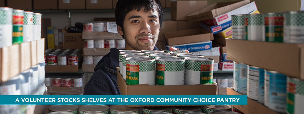 A volunteer stocks shelves at the Oxford Community Choice Pantry