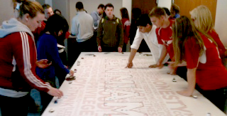 Miami students leaving thumbprints on the I am Miami sign