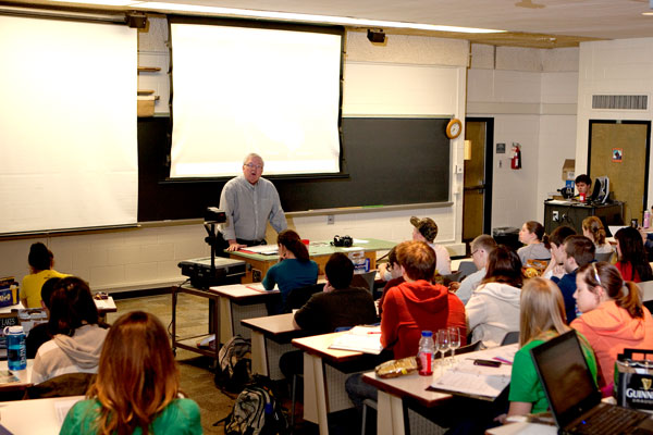 Professor teaching class to students
