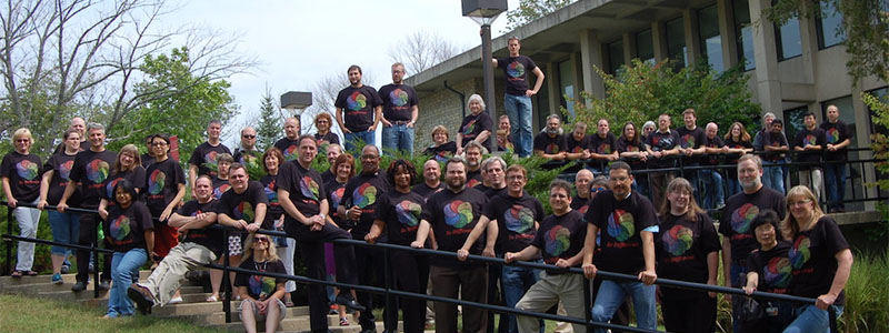 IT Services staff posing outside Hoyt Hall, displaying their diversity shirts