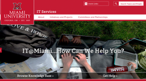 top section of the IT Services website homepage showing hands typing on a keyboard with the words IT at Miami how can we help you?