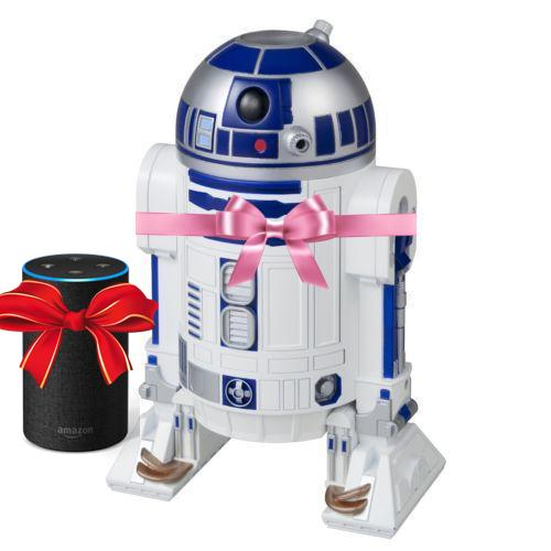 An Amazon Echo with a red bow next to a toy R2-D2 with a pink bow