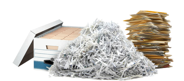 Box of file folders next to a pile of shredded paper and a stack of files