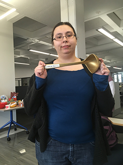 Emily Schmidt holds the golden ladle, the winning trophy of the Chili Cook-off