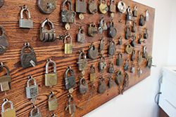 A wall of antique locks and keys