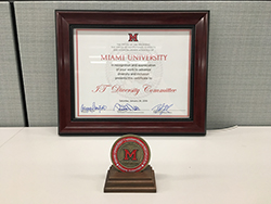 Plaque and medal given to IT Diversity Committee for excellence in promoting diversity and inclusion