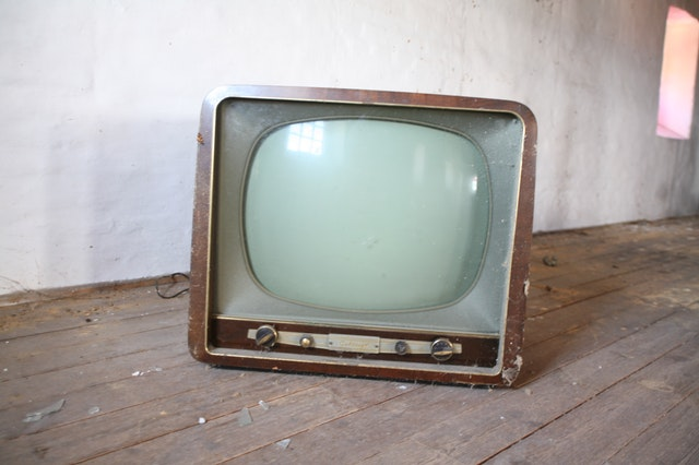 Old TV sitting on a wood table